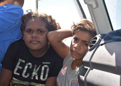 two teenagers in the car door
